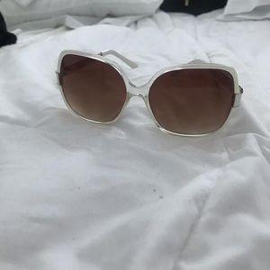 White Frame Sunglasses.